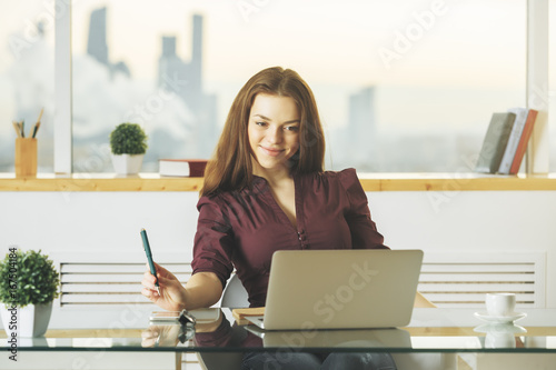 Fridge magnet Attractive white woman using laptop