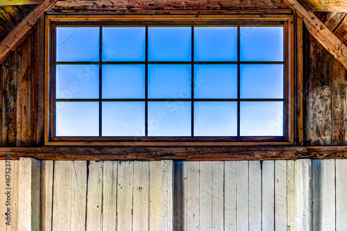 Looking through old rustic window of house with ocean view in Bonaventure Island, Quebec, Canada in barn - 167523798