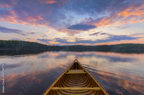 Bow of a cedar canoe on a lake at sunset - Ontario, Canada