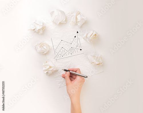 Writing hand in crumpled paper