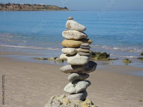 balancing stones at beach