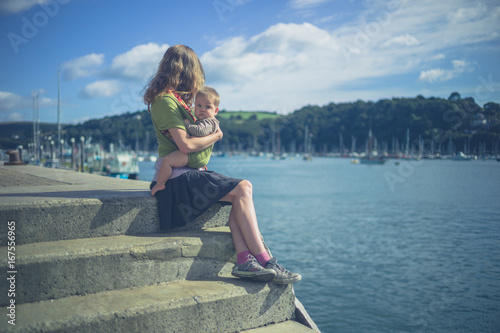 Young mother with baby by the river