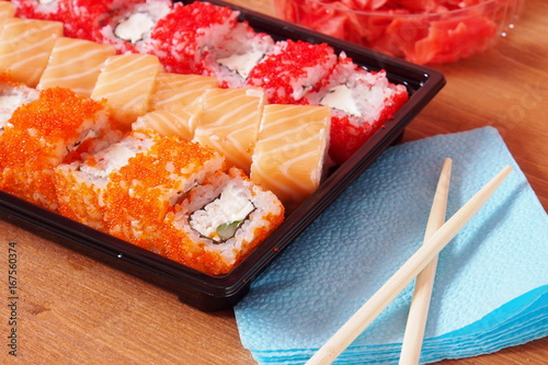 Rolls and sushi on the table in the package Poster