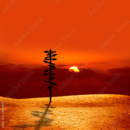 Fotobehang Rood directional sign and sunset