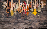Various of spices and herbs in wooden spoons. Flat lay of spices ingredients chilli ,pepper corn, garlic, thyme, oregano, cinnamon, star anise, nutmeg, mace, ginger and bay leaves on shabby wooden.. - 167585107