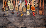Various of spices and herbs in wooden spoons. Flat lay of spices ingredients chilli ,pepper corn, garlic, thyme, oregano, cinnamon, star anise, nutmeg, mace, ginger and bay leaves on shabby wooden. - 167585124