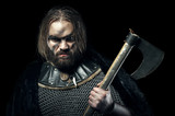 Formidable viking in armor and axe on black background - 167594722