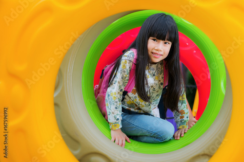 Zdjęcie XXL Asian kid fun i happy from zagraj w ring donus w playgroung