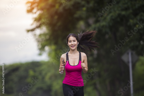 Poster Beautiful woman running in forest
