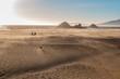 Quadro Family Walking on Sand Towards Ocean
