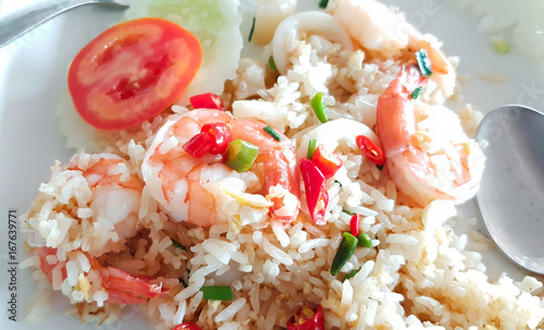 Fried rice with shrimp on white square tile plate © Jiranat-K