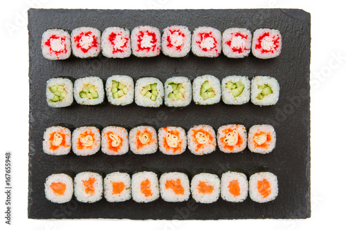 Big set of japaneese nigiri and roll sushi on black surface. Top view