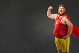 A funny fat man in a superhero costume - 167661358