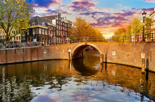 Channel in Amsterdam Netherlands Holland houses under river