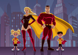 Superhero Family 2 / Superhero family posing in front of cityscape at night.