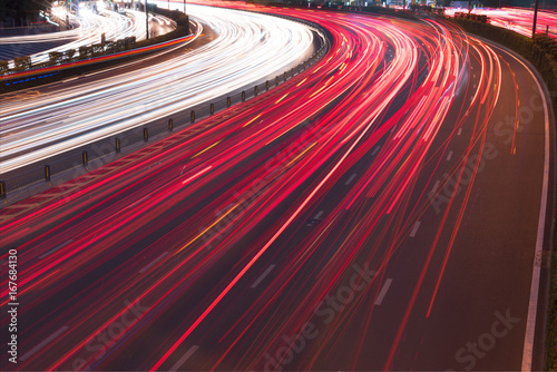 Fototapeta Cars light trails on a curved highway at night, Chengdu, China
