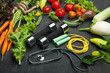 Quadro Fresh vegetables. Diet, a healthy lifestyle. Sport, dumbbells and skipping rope on a black background