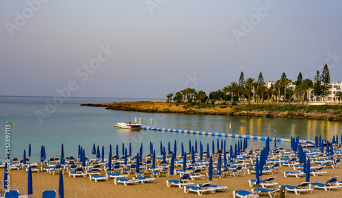 August 2, 2017.Protaras.Chairs with umbrellas on the beach in Fig tree Bay in Protaras .Cyprus.