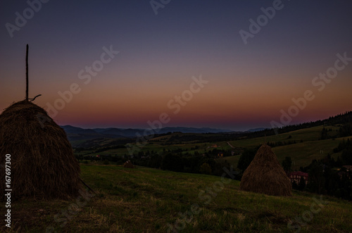 Background with Ukrainian Carpathian Mountains during the sunset in the Pylypets