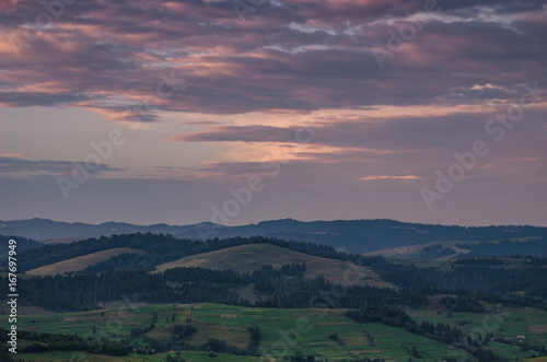 Foto op Plexiglas Zalm Background with Ukrainian Carpathian Mountains during the sunset in the Pylypets