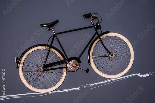 Fotobehang Fiets Vintage bicycle on the black wall