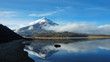 Cotopaxi volcano reflected in the water of Limpiopungo lagoon on a cloudy morning - Ecuador