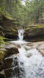 Water cascading down rocky hillside