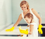 Mother with child washing kitchen