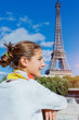 Beautiful girl in Paris with Eiffel tower
