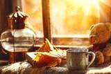 Autumn still life. A window,  hot tea mug book