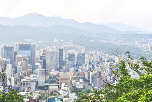 Beautiful Scenery of Downtown Seoul with Mountain Range in the Background