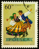 Man and woman in Polish folk costumes