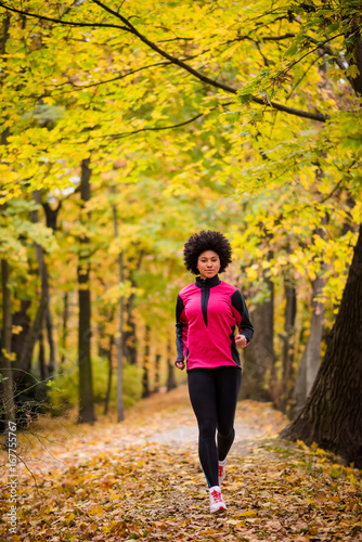 Teenager jogging in an autumn park