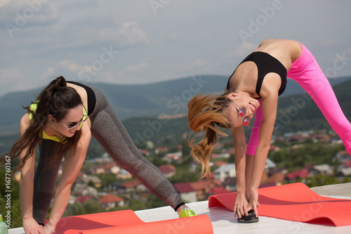Women at sport workout on fitness mat