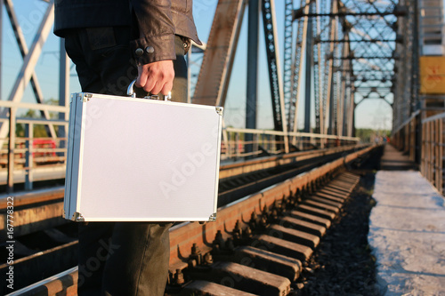 Foto op Aluminium Spoorlijn silver metal case with money transfer concept