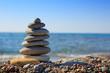 Quadro Spa stones balance on beach.