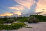 Dramatic tropical sunset on wild South Florida coastline