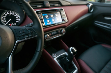Interior of the new car with infotainment display with touch screen.