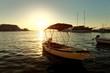 Small boats, fishing trawler and a sailboat moored in the harbor of a town Postira - Croatia, island Brac