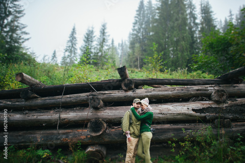 Foto op Canvas Khaki Young beautiful couple on a wooden background