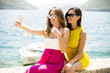 Quadro Two pretty young women taking selfie by the sea
