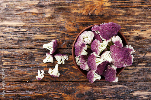 Purple cauliflower on a wooden table