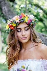 Wedding hair style - bride with flower wreath, bridal event. © sharafmaksumov
