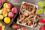 Autumn food. Mushrooms and fruits