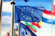 Quadro EU flags waving over blue sky. Brussels, Belgium