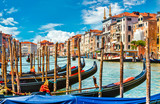 Grand canal in Venice with gondola boat blue sky and white cloud