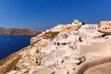 Typical Greek church and white houses in Oia or Ia on the island Santorini, Greece - 167839903