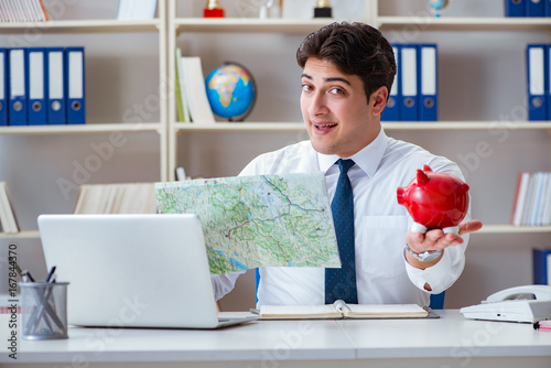 Businessman traveling agent working in the office - 167844370