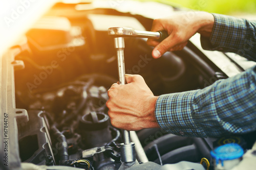 Sticker Auto mechanic working with wrench in engine. Car repair service