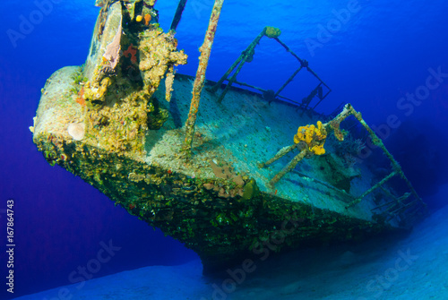 Foto op Canvas Schipbreuk A shot of the sunken shipwreck of the captain keith tibbetts on little cayman. This old russian destroyer has been sunk to make an artificial reef for marine life in the ocean and for scuba divers